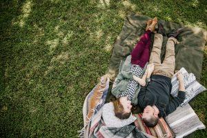 couple-talking-and-lying-in-the-grass