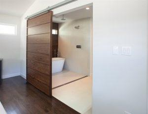 sliding-barn-door-leading-to-bathroom